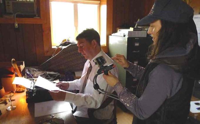 Diana films actor John Strachan (Neruda) at his typewriter.