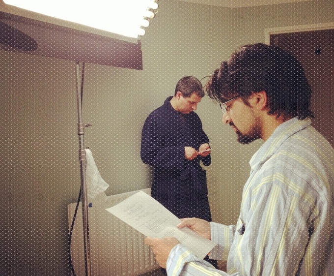 Ajay, in pyjamas, reads Nadaav's script.