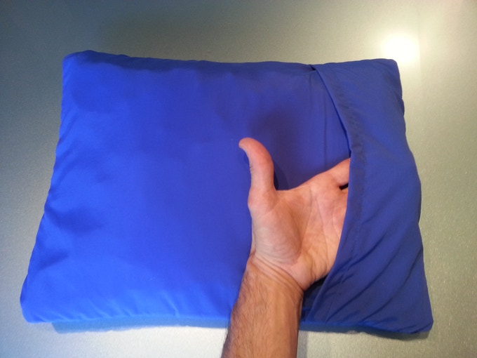 The back is unique with it's reversible opening and has a different cushy feel than the front smooth side. It is quite a fun pillow to sleep on