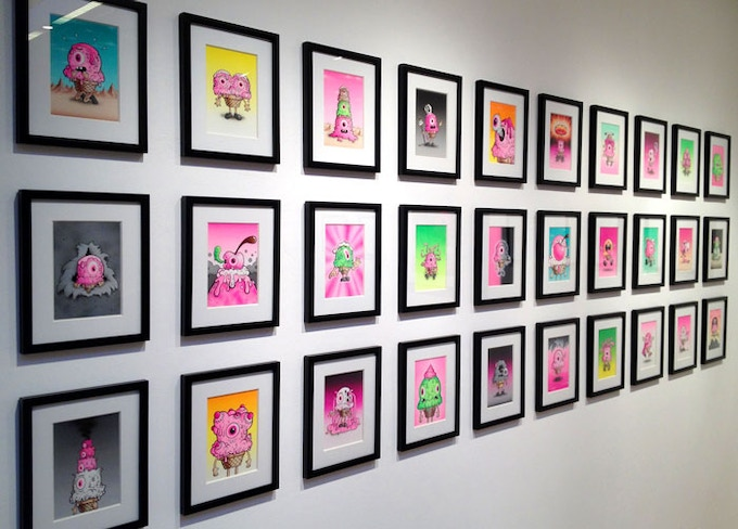 Series 1 Melty Misfits paintings framed and displayed.