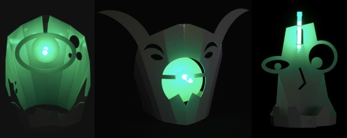 $40 - GET YOUR GLOW ON / Your choice of 1 of 3 whimsical glowing hats—Fanged Cyclops, Ferocious, or Smarty—designed by artist Wil Natzel exclusively for Northern Spark. Material: Reflective White Corrugated Plastic, 2mm thick. Glow stick included.
