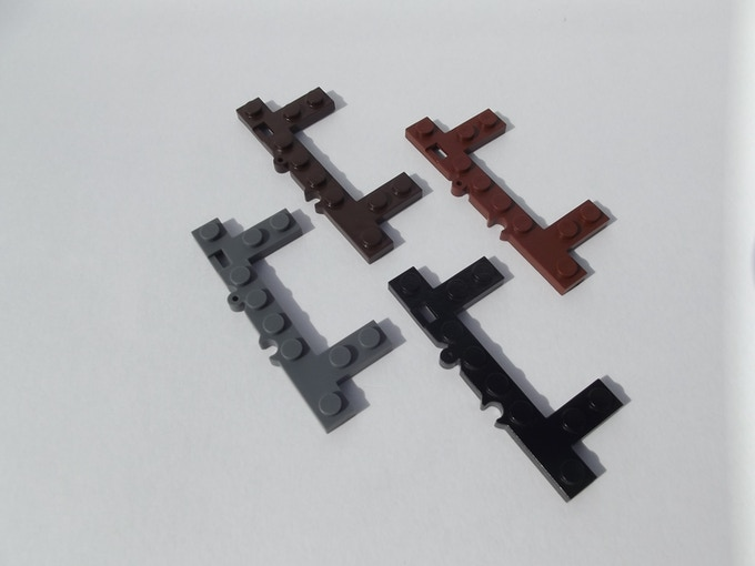ME Models Universal Connectors in dark blue gray, dark brown, reddish brown, and black.