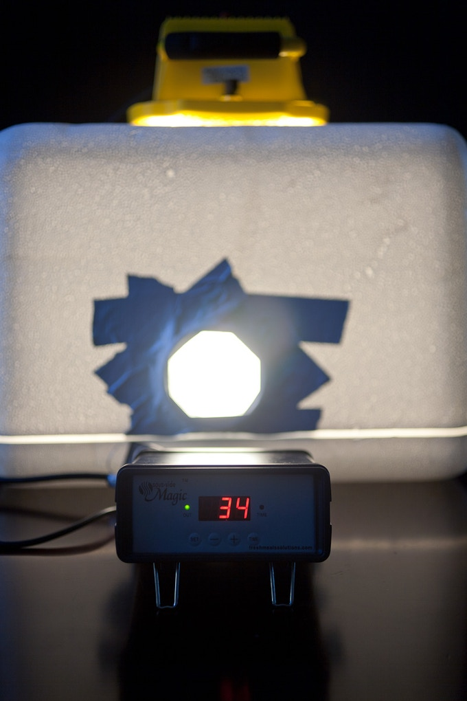 A heating chamber used to warm chocolate to 94℉ (just under its melting point), made from a foam cooler, a halogen work light, and a PID temperature controller. (2011)