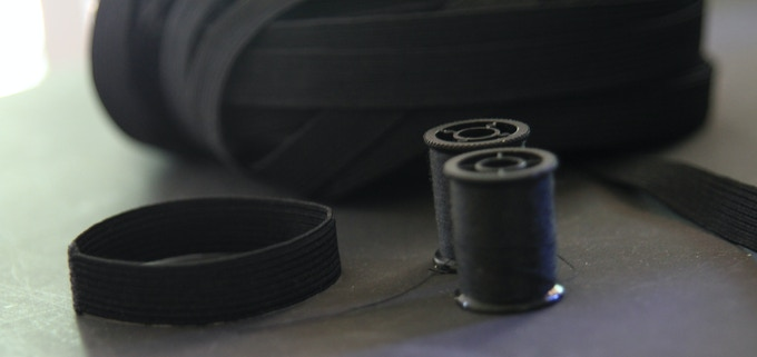 Elastic bands are quad-stitched for durability.
