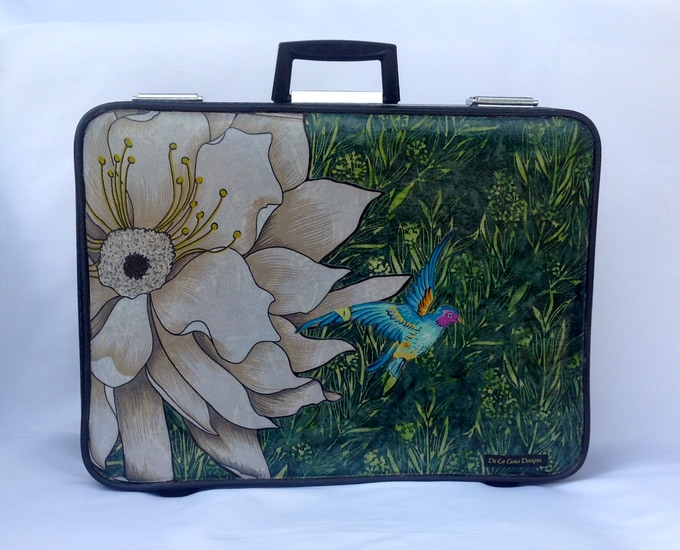 """""""I release you and let you take flight"""" One Of A Kind Luggage made from recycled suitcase, recycled skirt and fabric. Retail value $240.00 It includes a signed copy of QUETZANIMALES."""