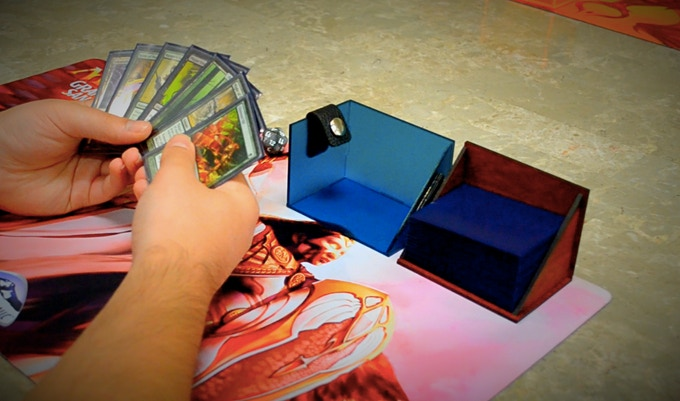 DECA being used as a holder for playing cards, acrylic can also be used for space.