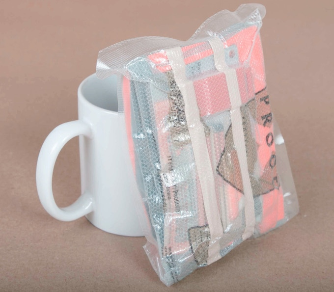 The $90 reward.  Travellers Extract Module, vacuum sealed, 8 ounces. (mug for perspective, not included)