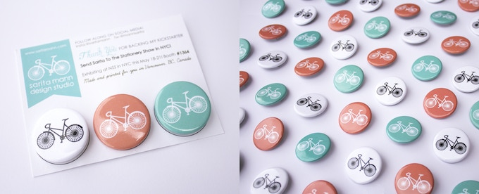 """3 Sweet ass circle buttons (1.25"""" D). Sweet bike logo floating in 3 rad colours: White, Salmon, & Mint. What's not to love? You'd be hard pressed to pass these little suckers! Keep'em for yourself or give them away!"""