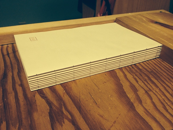 A notebook waiting to be sewn.