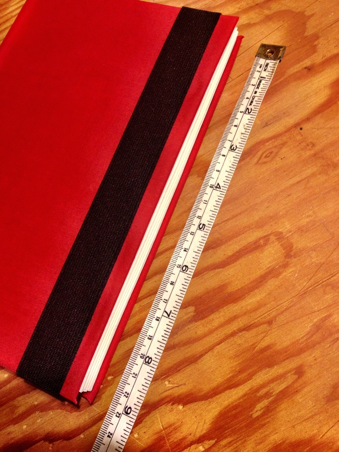 RED M&B Notebook to scale.