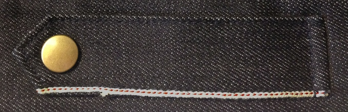 Additional selvedge accents along waist tabs.