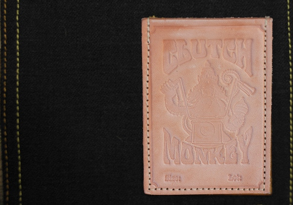 Tanner Goods heavy weight 7 oz. stamped English Bridle leather patch - located on inside lower pocket.  Also a motorcycle key pocket.