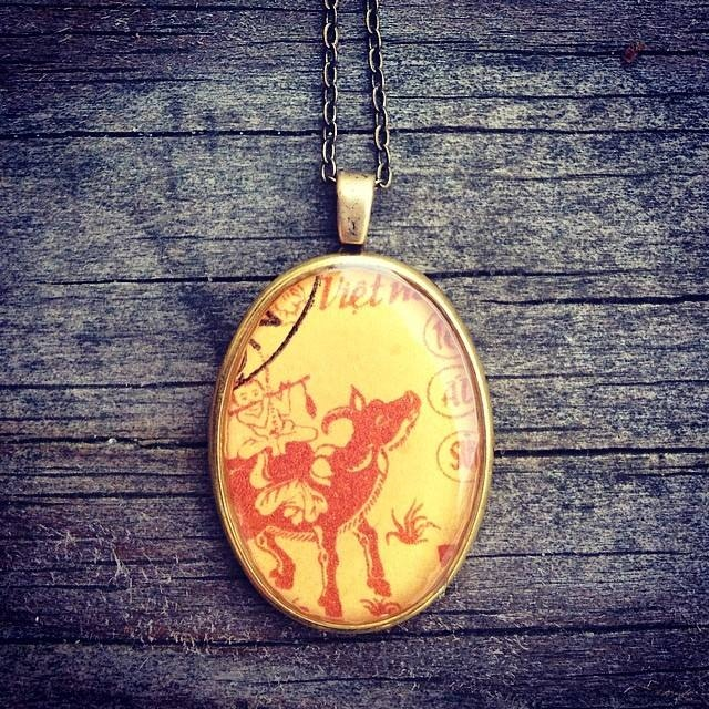 a beautiful personalised pendant holding the cover art.