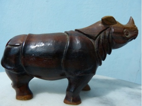 Hand Carved wooden Javan Rhino (approx.15 cm long) made by the villagers living next to Ujung Kulon National Park in Java.
