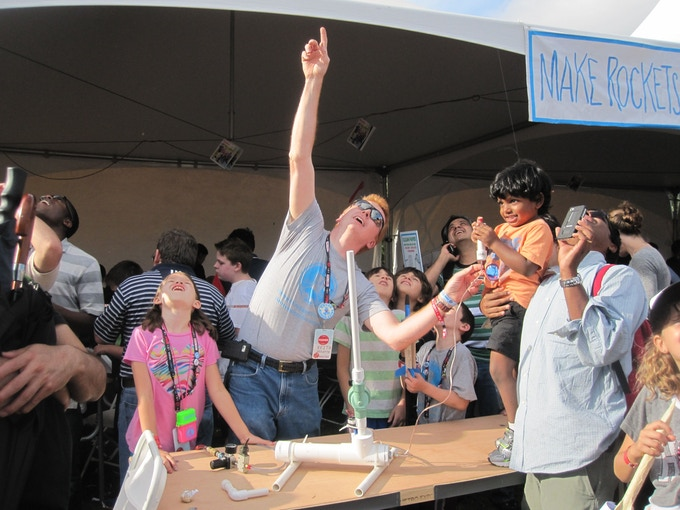 Keith and his kids helping an excited young rocketeer at the NY Maker Faire