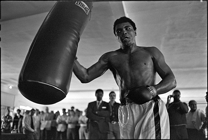 < K > Ali working out on the bag