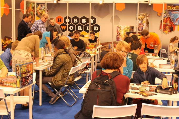 Essen 2013. You can see Nikolay Pegasov, the game author, standing just left of the Hobby World logo. He had a great source of inspiration for creating new cards. It was players' feedback!