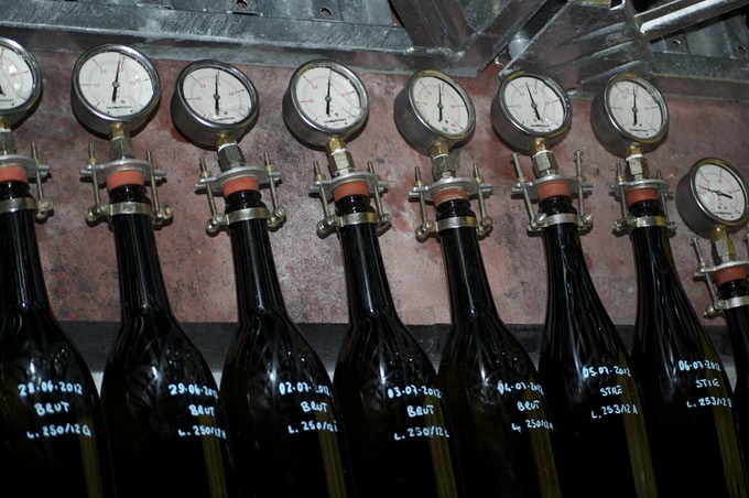 An industry example of pressure monitoring: Samples of each lot of bottled wine during secondary fermentation with manometers that measure the amount of pressure inside in order to monitor CO2 production in the bottle.