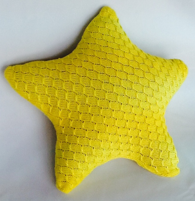 Shining Star Award: 100% Cotton cable knitted pillow ($25)
