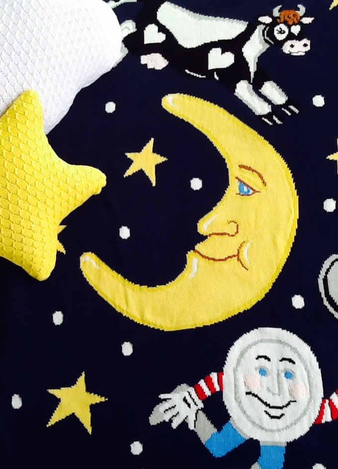 Hey! The Dish Ran Away with the Spoon: Limited Edition Daisy & Blu knitted blanked in navy with Star & Cloud shaped pillow accessories ($275)