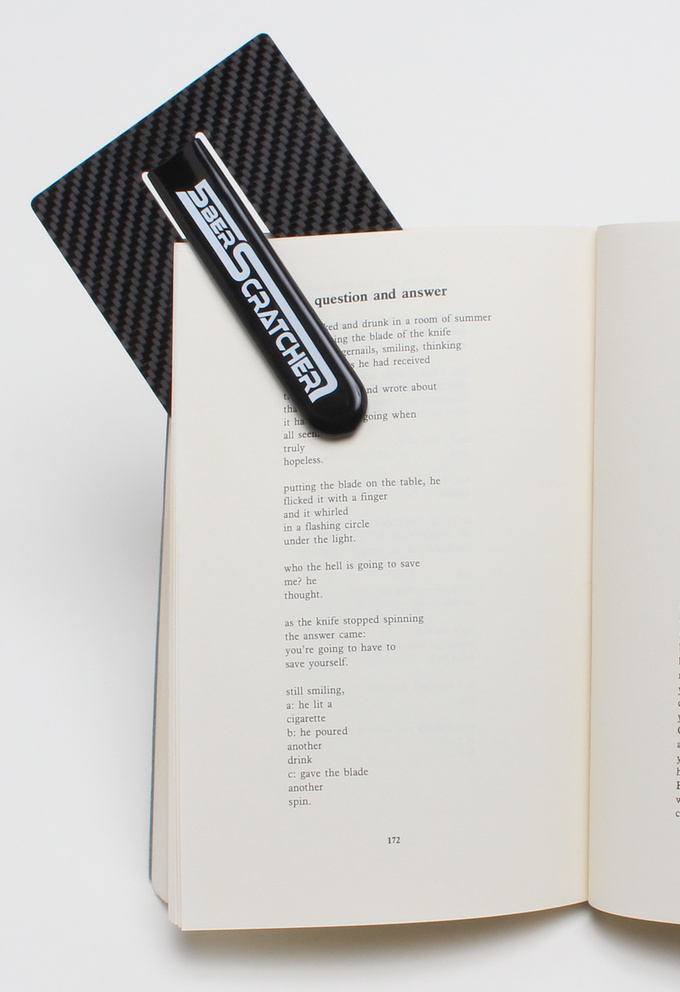 Genuine carbon fiber backer-plaque doubles as a cool bookmark (photography by Martin Lyon, Los Angeles)