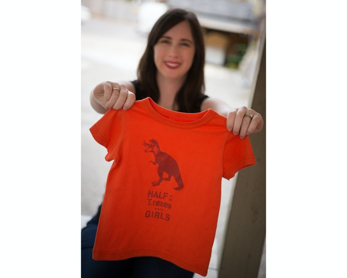 Jenn with our flagship T.rex shirt. (Photo: Sara Shirley)