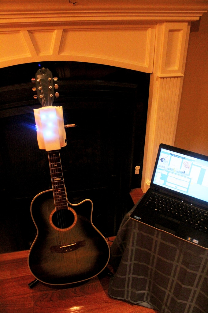 RoboTar attached to an Acoustic Guitar and Software running on a Laptop.