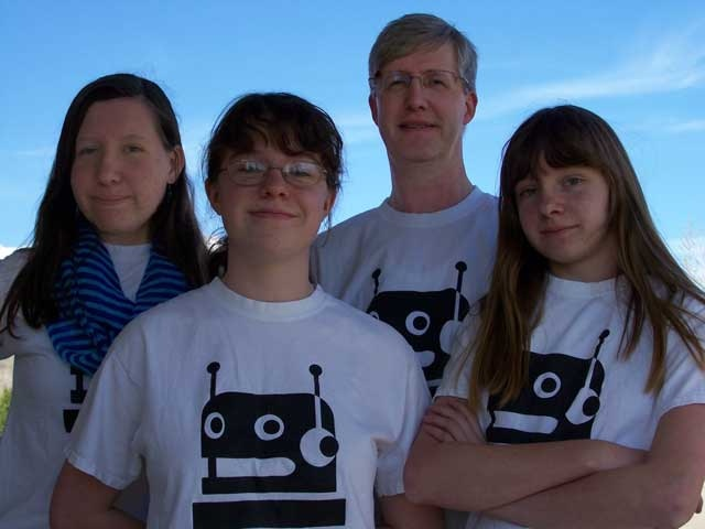 Camille, Melanie, Wayne, Natalie, and Cassie (not shown)  ready to help as members of The Educated Robot team