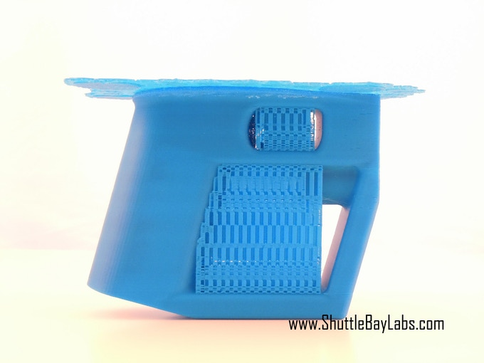 Handle straight from the printer.  The raft (on the top) and the other support structures easily pop off