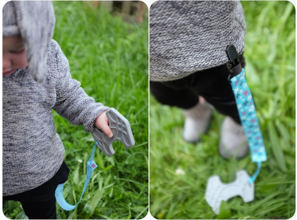Attacher ribbon: secures your baby's teether to their clothes.  No more teethers being thrown out of the pram! Photo representative only; stretch goal reward is plain black ribbon, not blue.