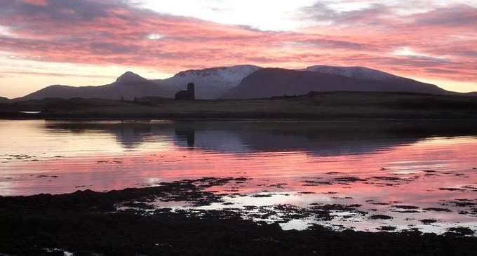 Sunset over Canna Bay, the setting for Away with the Birds.