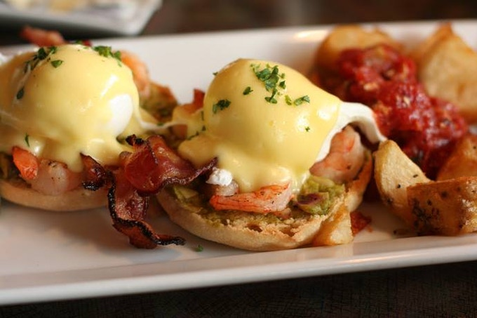 Our version of Eggs Benedict includes Bacon and Shrimp