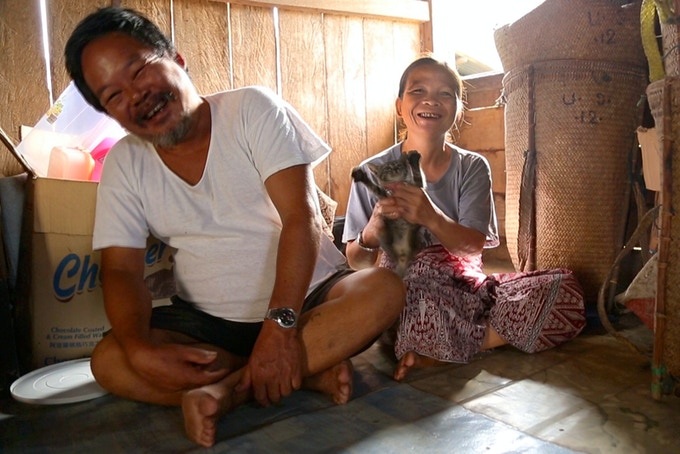 Indigenous family in longhouse in Borneo