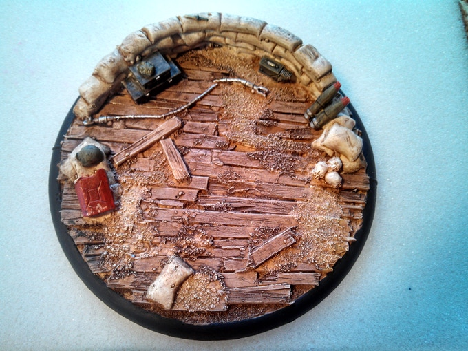 120mm base perfect for large models or even used for objectives or terrain pieces this piece complete with skulls and of course note the broken dagger on the sandbags this very large base is filled with a ton of details