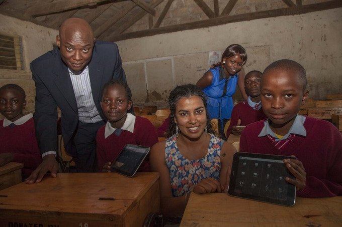 Qualcomm-Director-Business-Development-Billy-Owino-left-and-Nivi-Mukherjee-CEO-Elimu-with-students-of-Embakasi-Garrison-during-the-launch