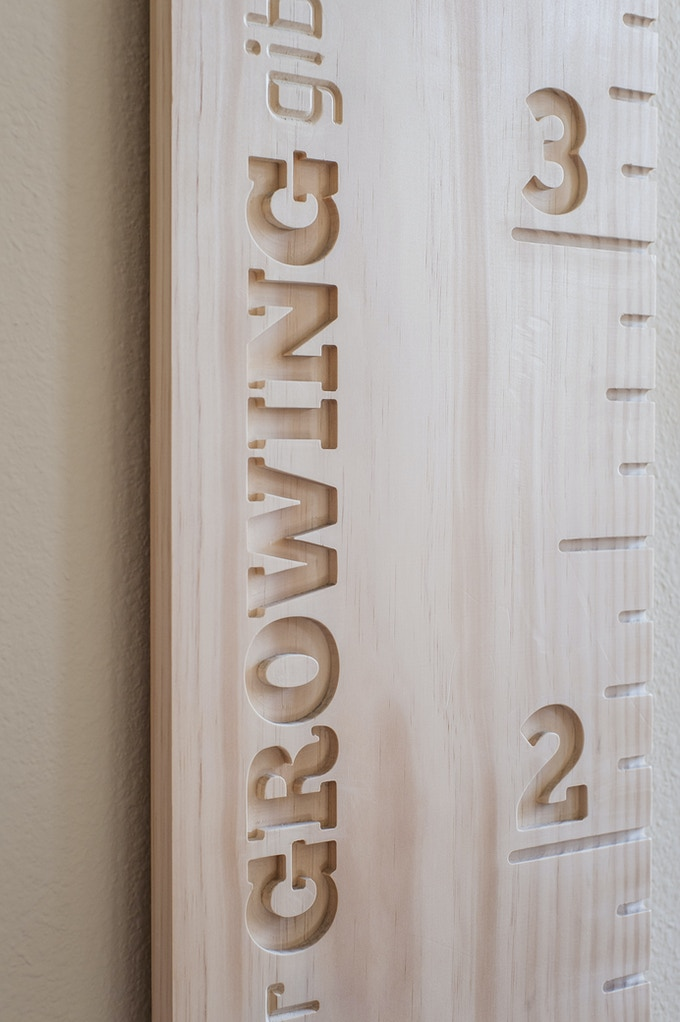 Detail of Board Title / Radiata Pine Board / Chuck Five Font / Left Natural - Without Lacquer Finish