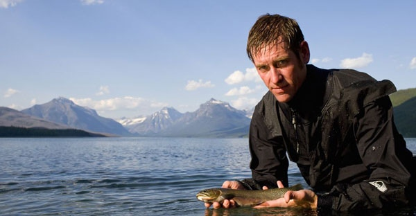 USGS ecologist Clint Muhlfeld with a westslope cutthroat trout in Glacier National Park, Mont. Photo by Noah Clayton/USGS