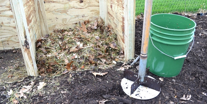 Compost Chopper system next to a compost bin.
