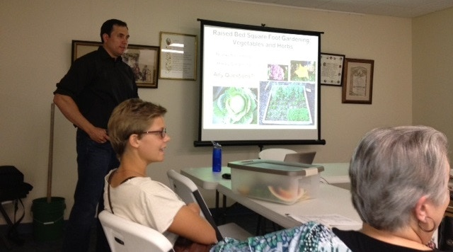 Eddie gives a talk on Raised bed gardening. See the chopper?