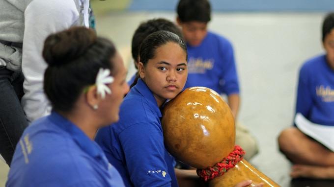 Hoʻonani plays the ipu heke under Kumu Hinaʻs supervision