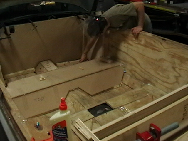 Using plywood, make a mock tub in the car's interior.  Try not to glue your fingers together more than fifteen times.