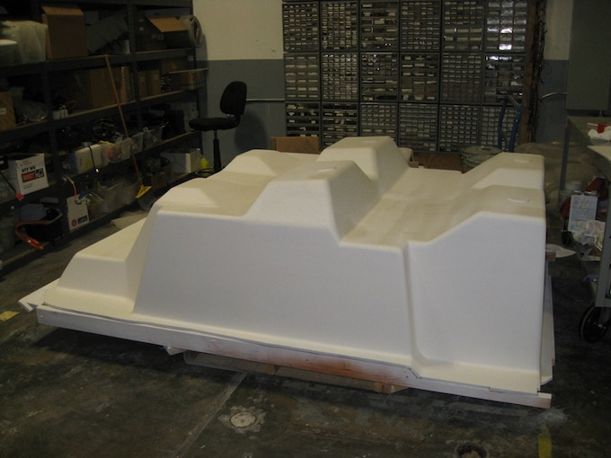 Using medium density fibreboard (MDF), make a negative tub mold.  Sand for what seems like a million days.  Spray many gallons of noxious chemicals onto it to make it smooth and shiny.