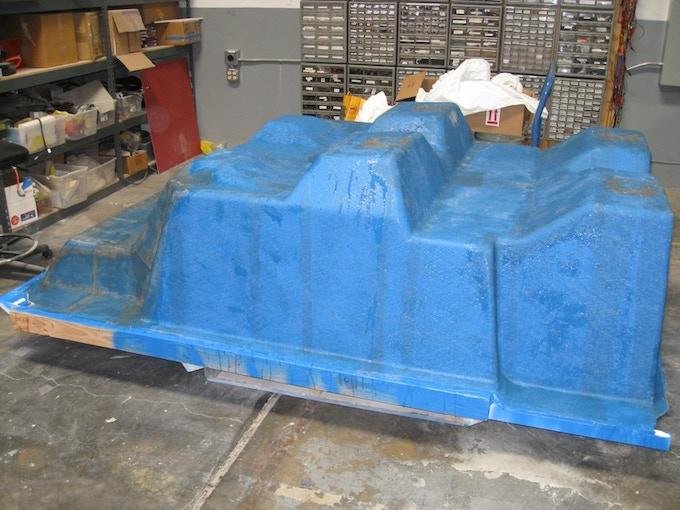 Lay up fibreglass onto the mold to create the custom tub.