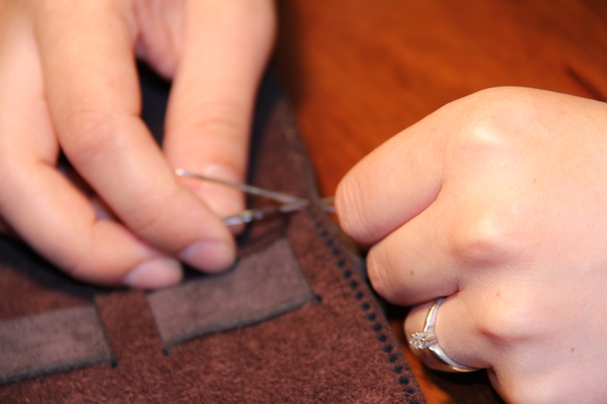 Hand Stiched by local group of trained artisans.