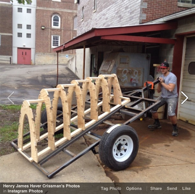 - The new custom built trailer held in its firing position with the kiln form arches in a jig representing the space that will be the interior of the kiln. -