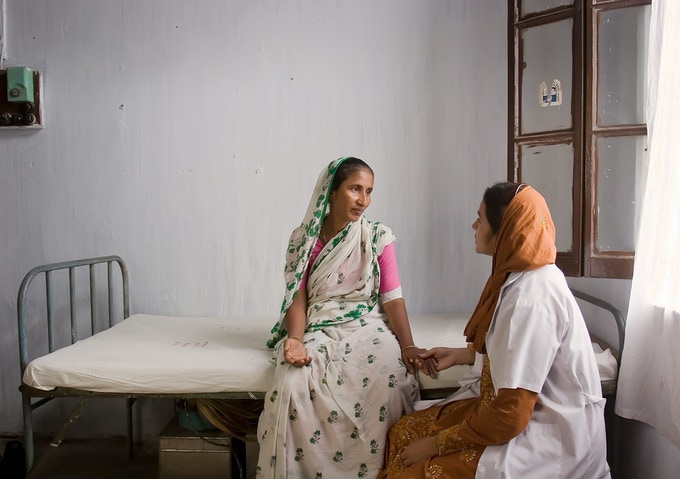 In Dhaka, Bangladesh, this woman just received a long-term birth control implant. She is being counseled by her physician.