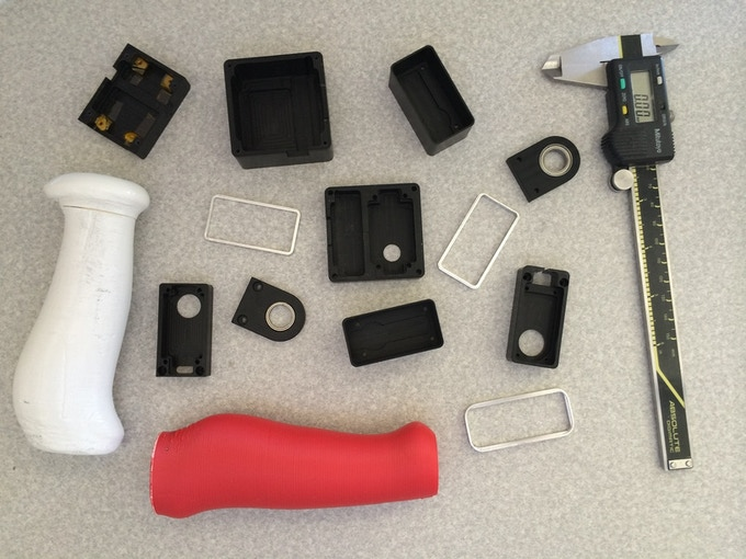 Early aluminum, delrin, and 3D printed parts