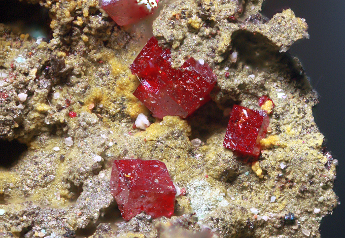 Cuprite (Red crystals), Stone Hill Copper Mine, Micaville, Cleburne Co., Alabama. These crystallized out in the slag from the smelting process.
