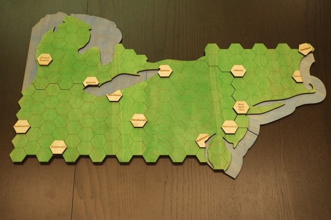 City tiles are not glued onto the board, they can be removed to allow board to be collapsed and placed into its box.  Note that Portland in Maine is shown off center to demonstrate.