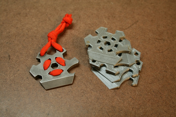 A few of the 3D printed prototypes and the first metal prototype